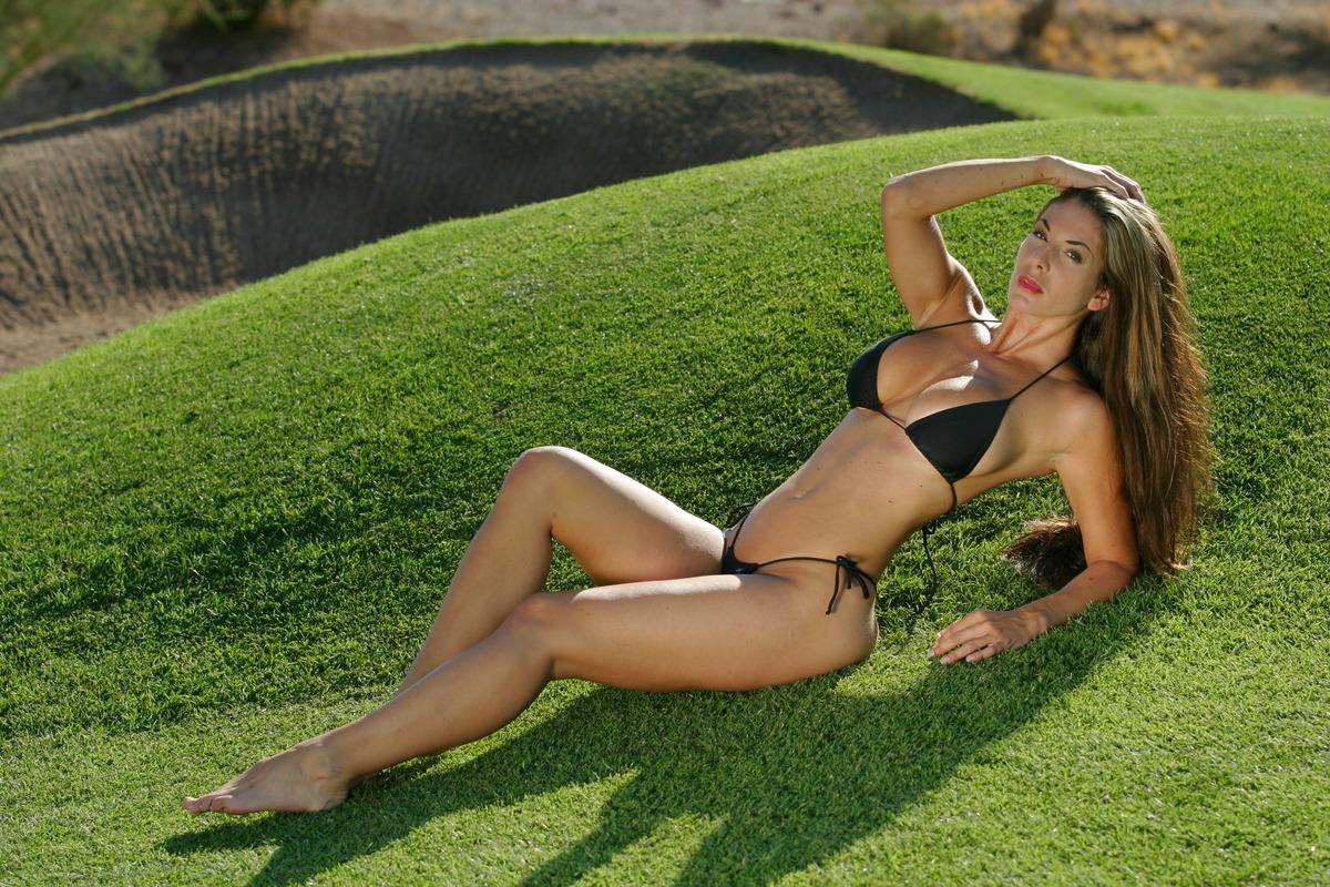 Sexy Girl auf dem Golfplatz